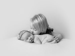 child kissing Baby Newborn Photographer Romford Essex